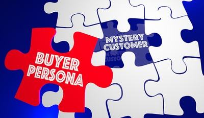 White puzzle pieces with the words mystery customer and buyer persona written on two of them.