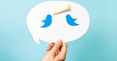 Two twitter bird logos in a speech bubble