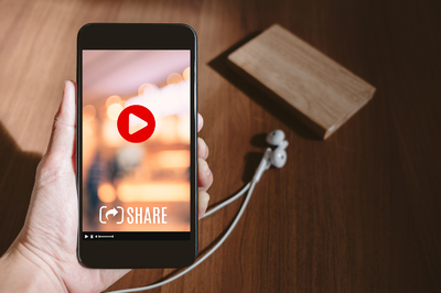 Mobile phone with video play button.
